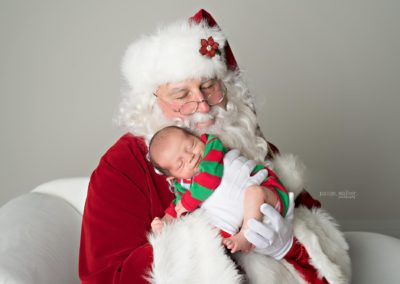 baby loving Santa Henry for hire