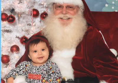 baby loving Santa Rob for hire