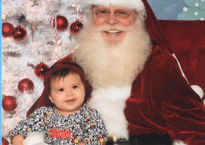 baby loving Santa Rob for hire