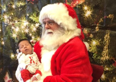baby's first photo with Santa Ron